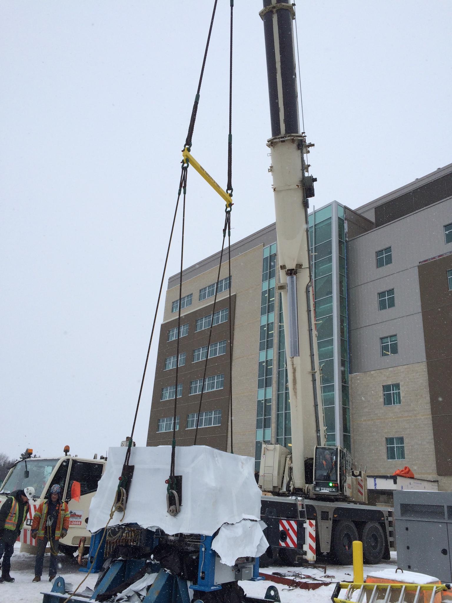 Lifting cyclotron by crane
